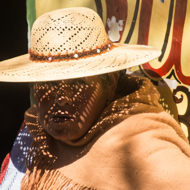"""A traditional Aymara woman with hat wait by the roadside in Uyuni town in Bolivia."" stock image"