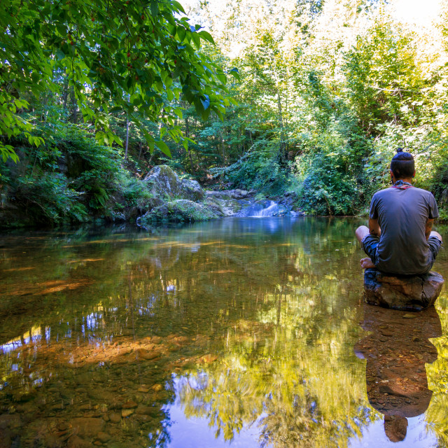 """man meditating in lake"" stock image"