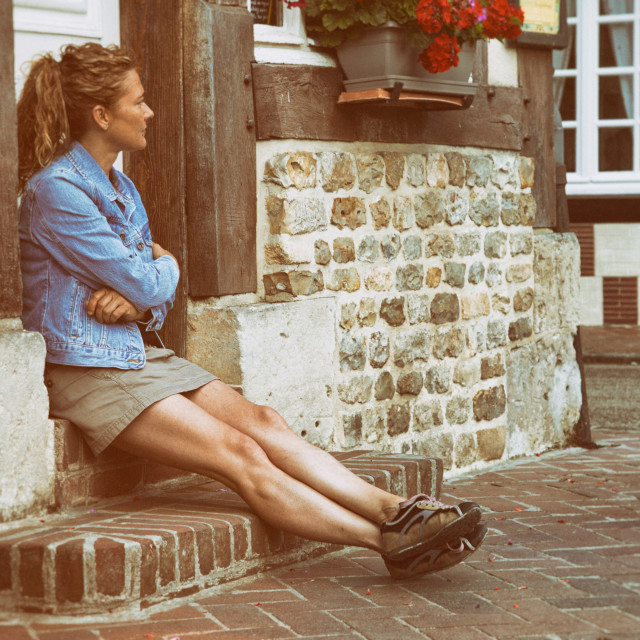 """""""Woman sitting at the door"""" stock image"""