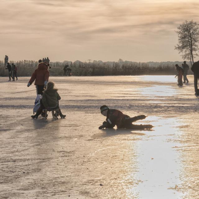 """Having fun on natural ice"" stock image"