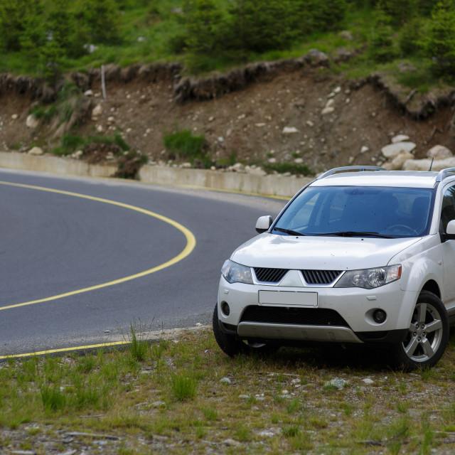 """Terrain car near the road"" stock image"