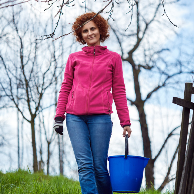 """Farmer lady with a bucket"" stock image"