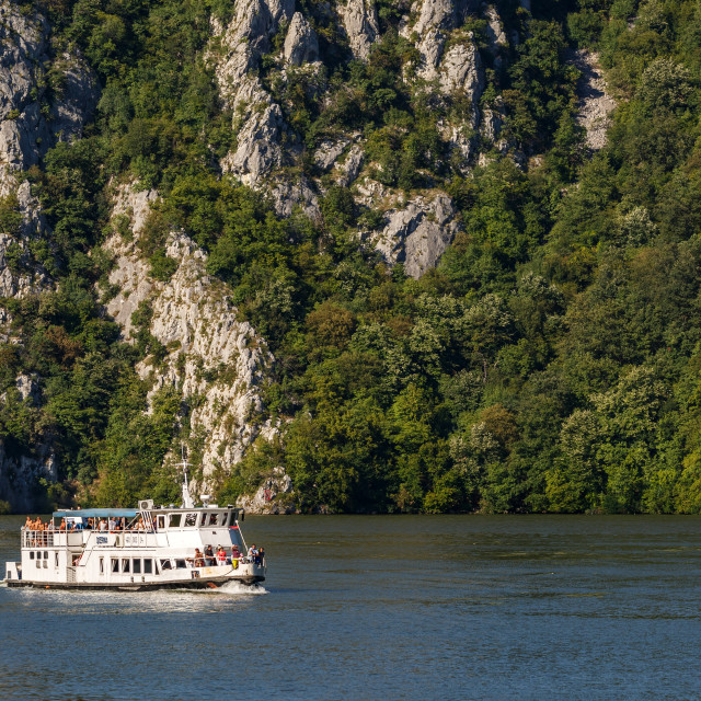 """Cruising ship full of people on Danube river"" stock image"