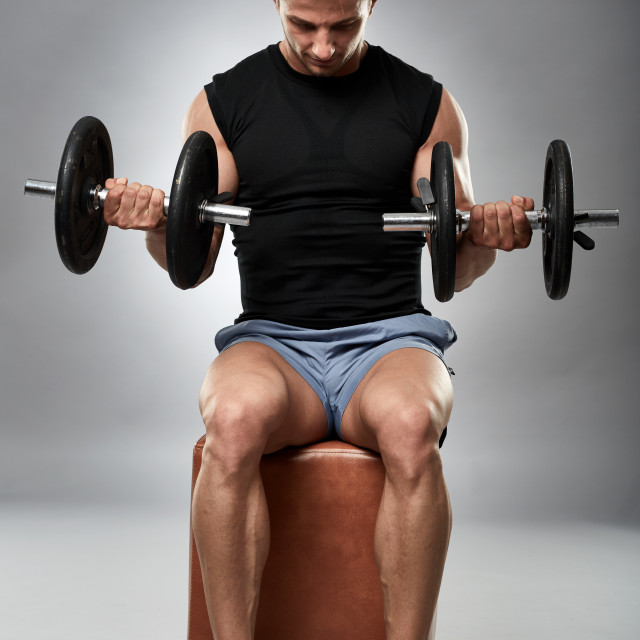 """""""Biceps curl in seated position"""" stock image"""