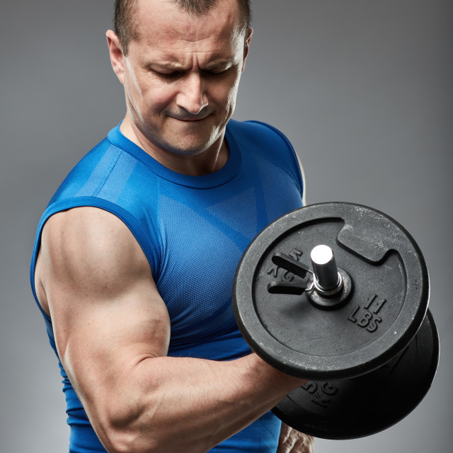 """""""Man doing biceps curl with dumbbell"""" stock image"""