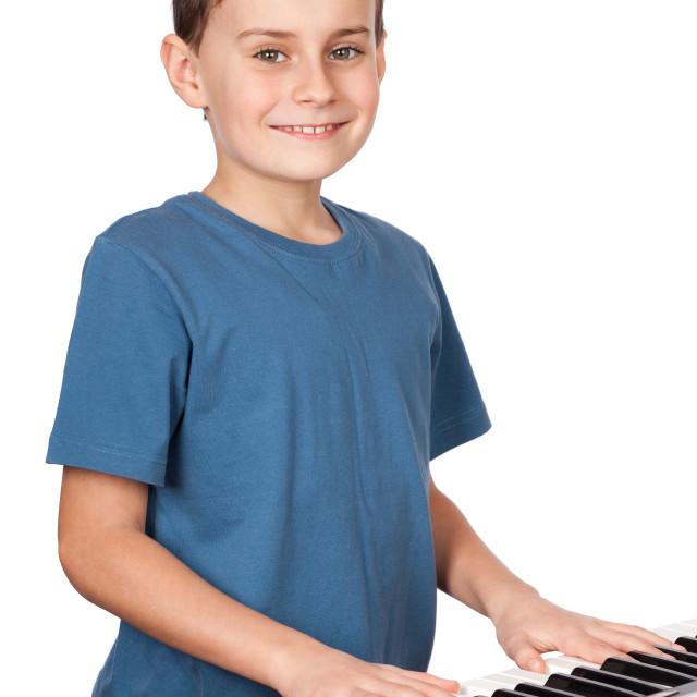 """Boy playing piano"" stock image"