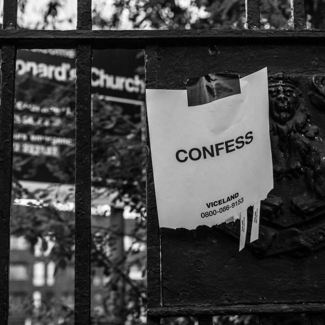 """Confess"" stock image"