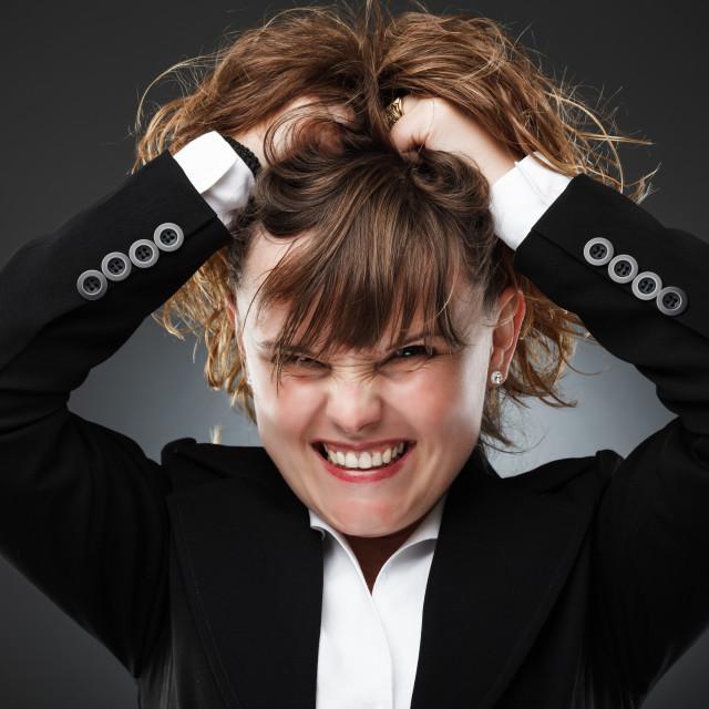 """Furious businesswoman"" stock image"