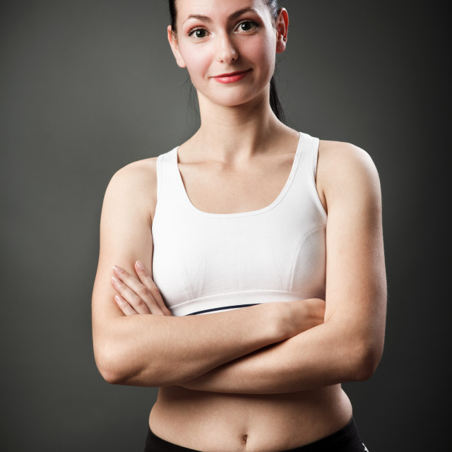 """""""Beautiful sporty woman with crossed arms"""" stock image"""