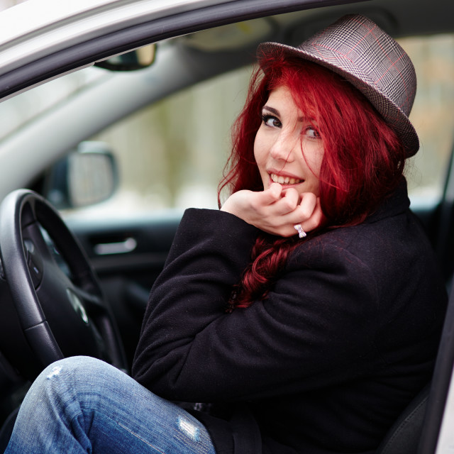 """""""Young girl sitting in the car"""" stock image"""