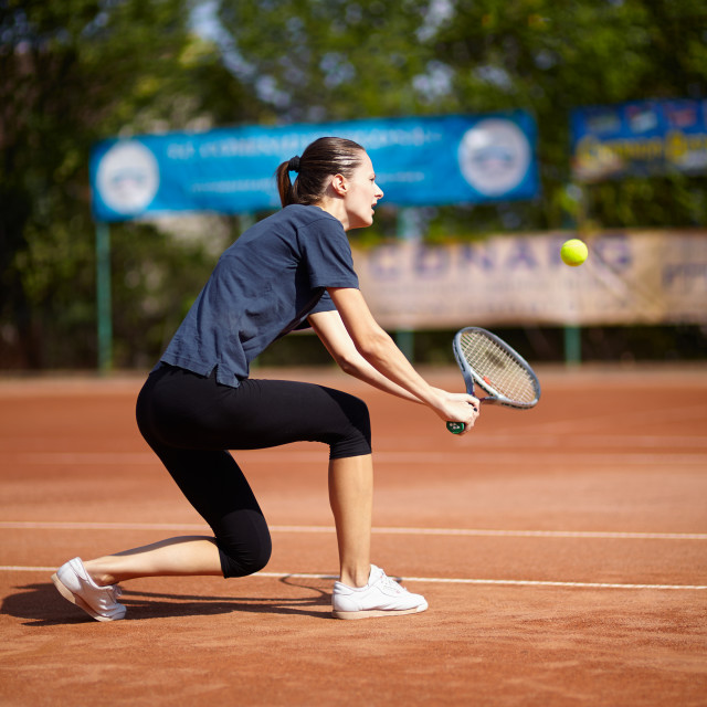 """Tennis player executing a backhand volley"" stock image"