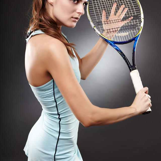 """Female tennis player preparing to execute a backhand volley"" stock image"
