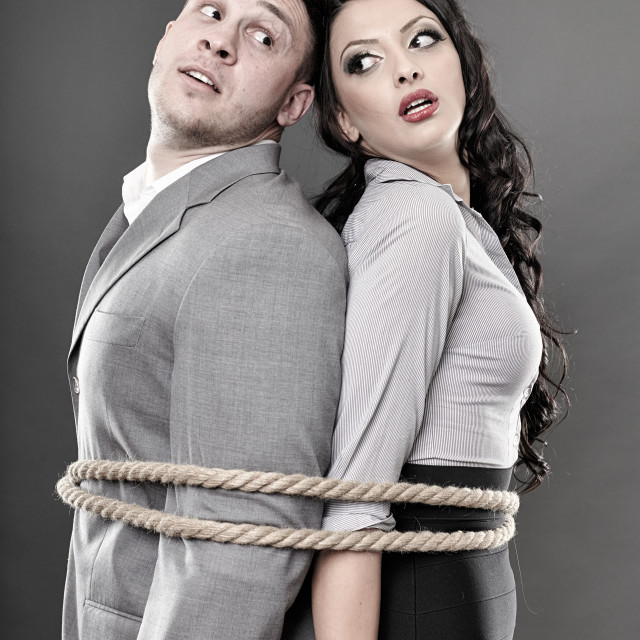"""""""Couple tied with a rope"""" stock image"""