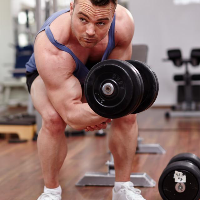"""""""Man working biceps"""" stock image"""