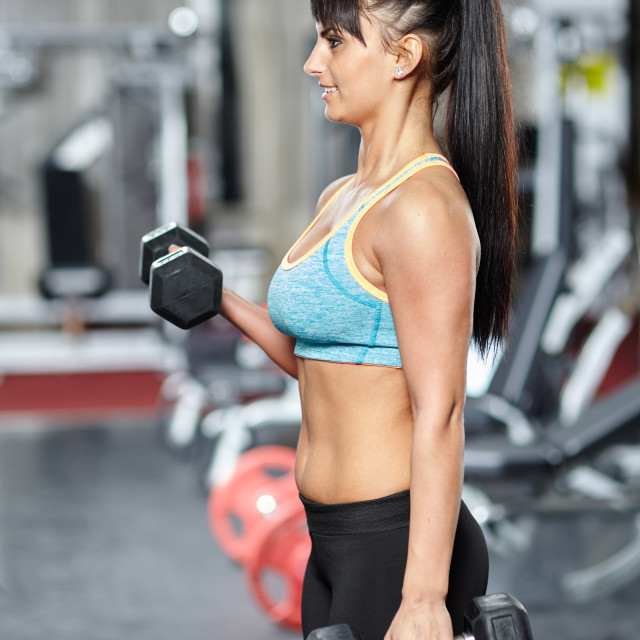 """""""Fitness woman biceps workout"""" stock image"""