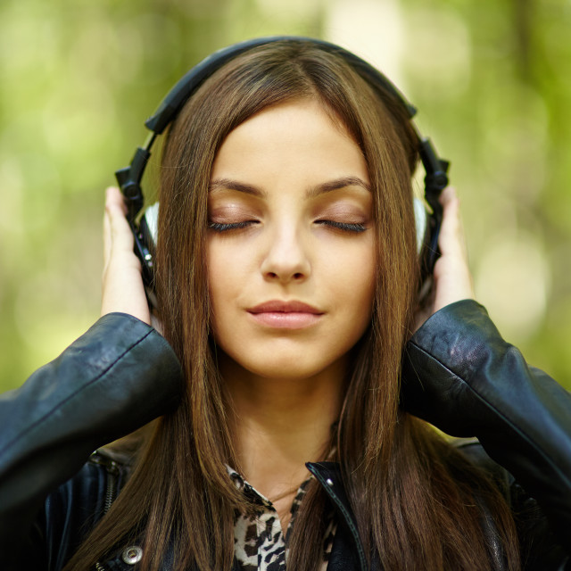 """Girl listening music outdoor"" stock image"