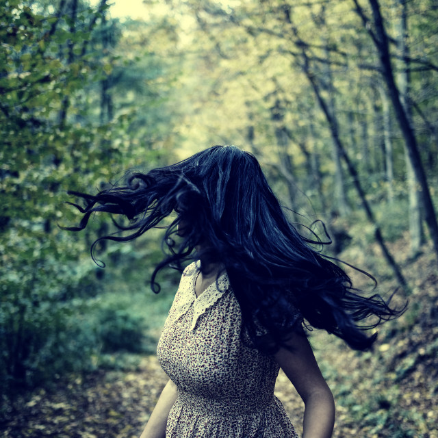 """""""Scared girl running in the forest"""" stock image"""