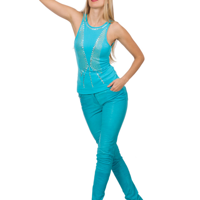 """Pretty blond woman in blue pants and shirt isolated on white"" stock image"