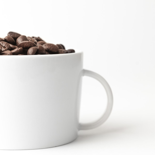 """Coffee beans in a cup"" stock image"