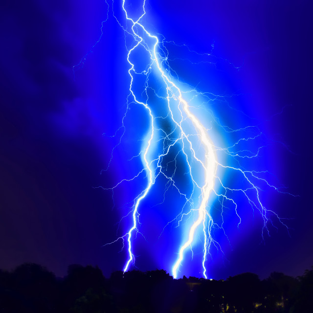 """Lightning strike on the dark cloudy sky"" stock image"