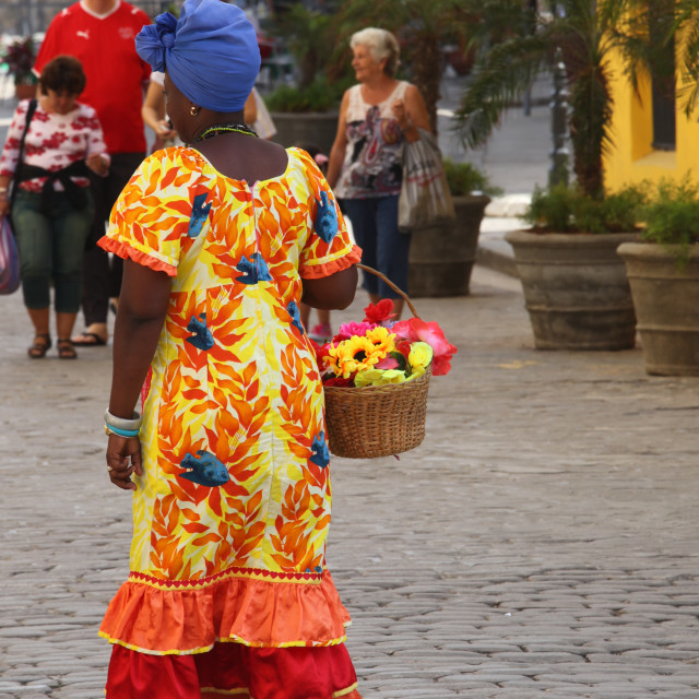 """Cuban woman in colorful dress"" stock image"