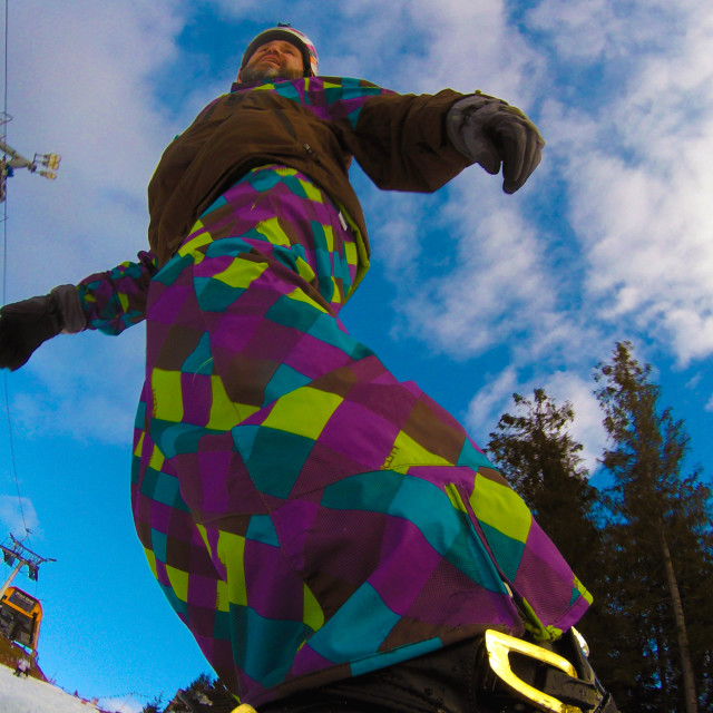 """""""Snowboarder on snowboard, view from below"""" stock image"""