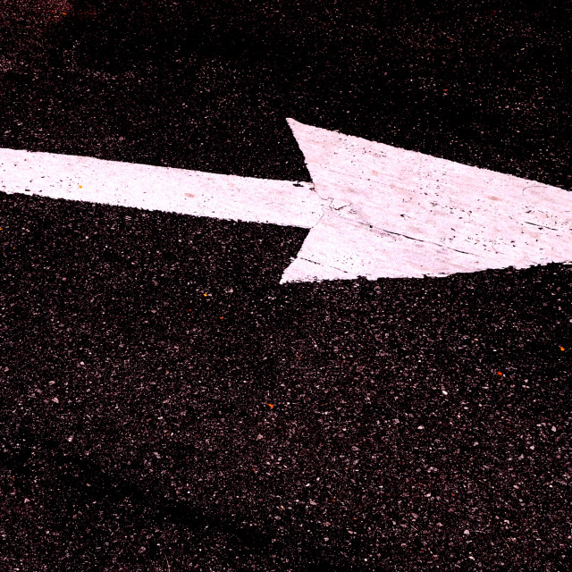 """""""Big white directional street arrow painted on asphalt and pointing right"""" stock image"""