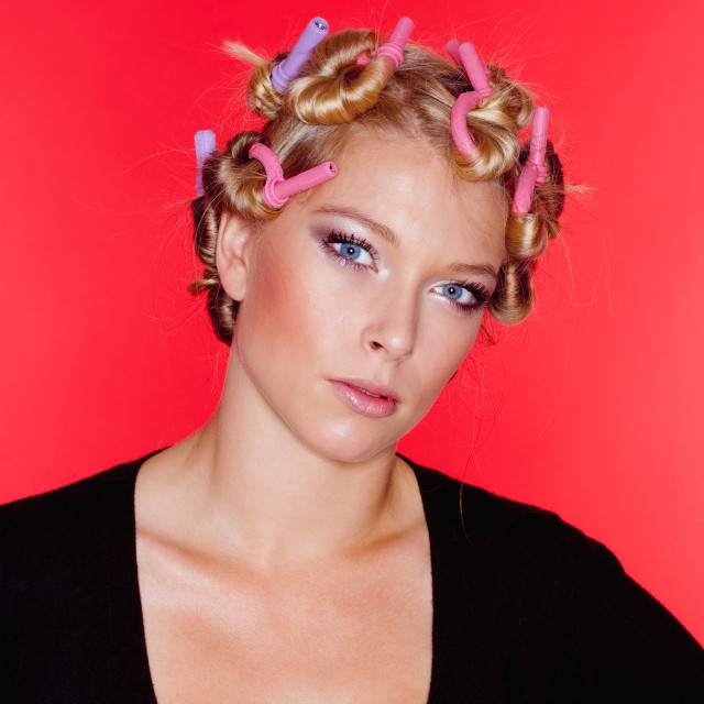 """""""young woman with hair rollers"""" stock image"""