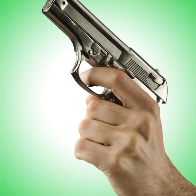 """""""Gun in the hand on white"""" stock image"""