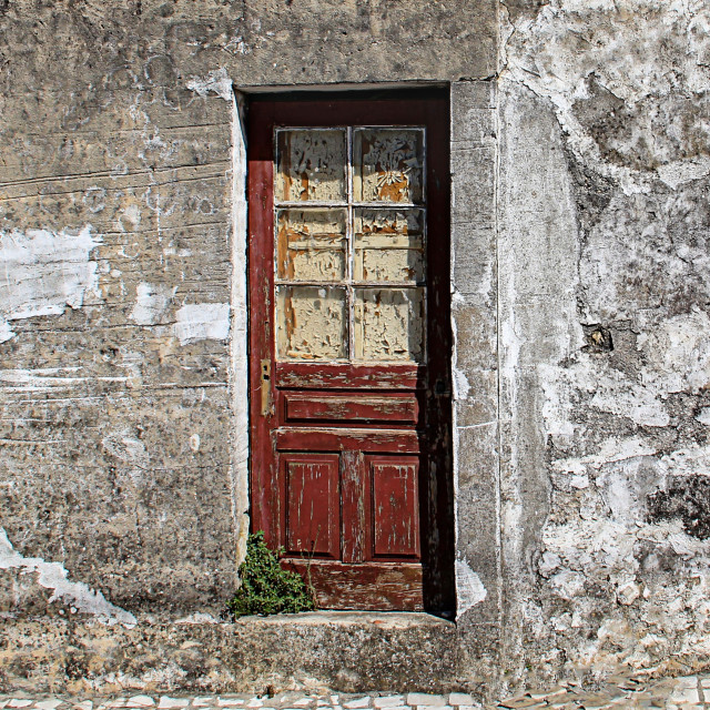 """Decaying Door in Porto de Mos, Portugal"" stock image"
