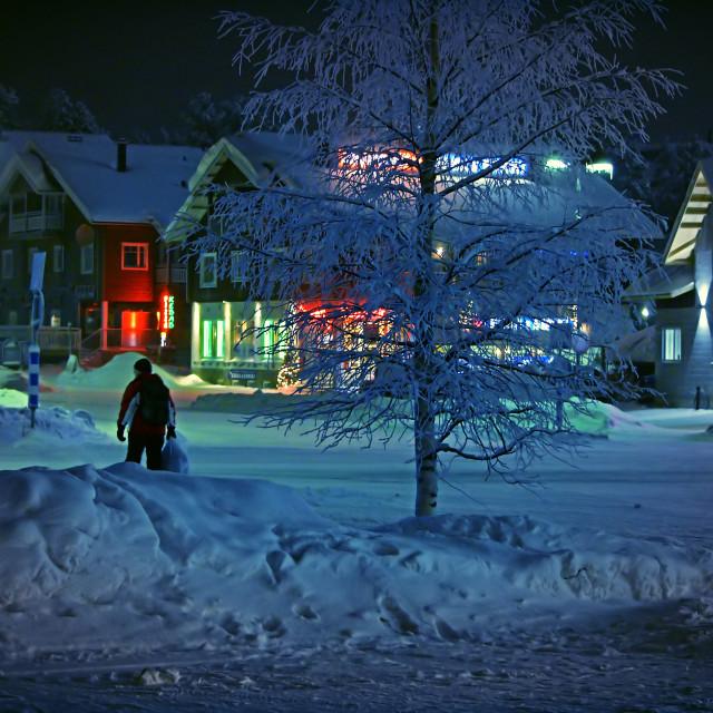 """A man walks through a wintered town"" stock image"