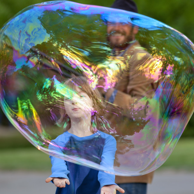 """Boy Cathing Large Soap Bubble Outdoors"" stock image"