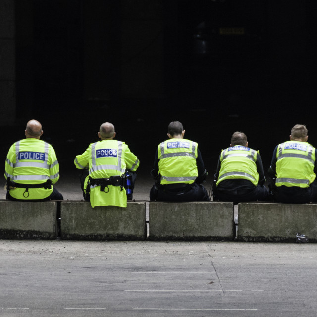 """Police resting during a protest"" stock image"