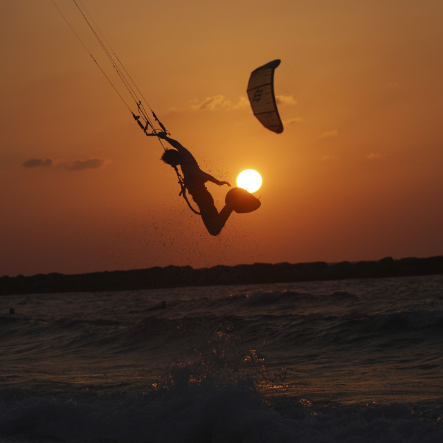 """Kite surfing at sunset"" stock image"