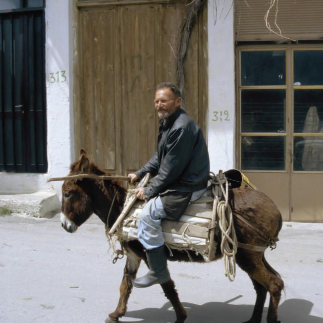 """""""CRETE, Local Man on Donkey"""" stock image"""
