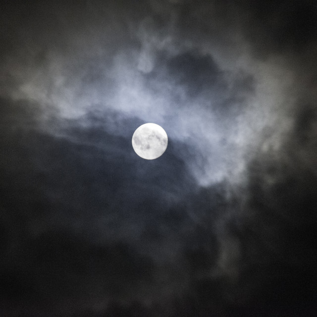 """Full Moon with Storm clouds at night"" stock image"