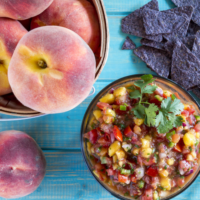 """Fresh organic yellow peaches and peach salsa"" stock image"
