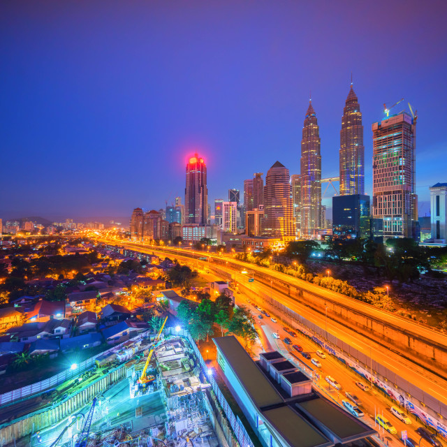 """High aerial view of Kuala Lumpur city during sunrise"" stock image"