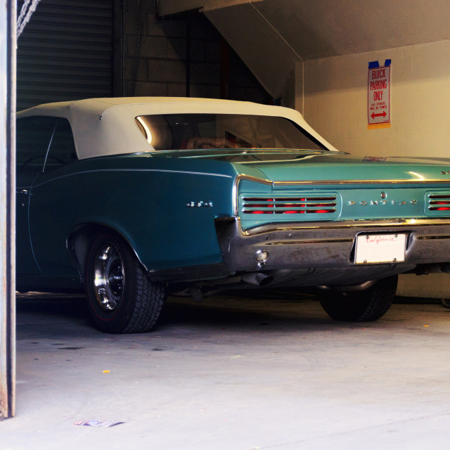"""""""Classic American car in a garage"""" stock image"""