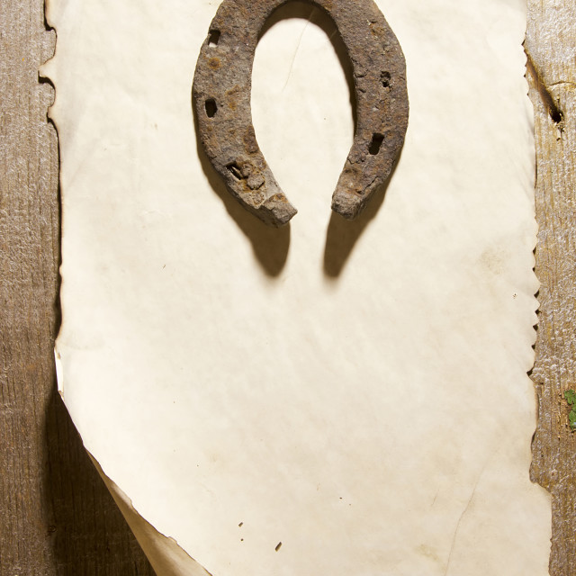 """""""Old horseshoe and a sheet of paper"""" stock image"""