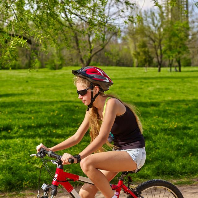 """Bikes cycling girl wearing helmet riding on bicycle lane."" stock image"