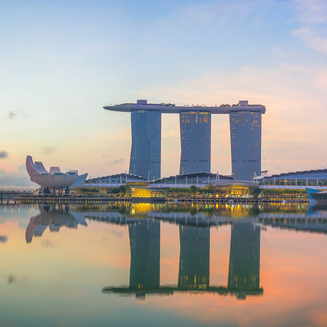 """Singapore,Singapore – April 2016 : Aerial view of Singapore city skyline in sunrise or sunset at Marina Bay, Singapore"" stock image"