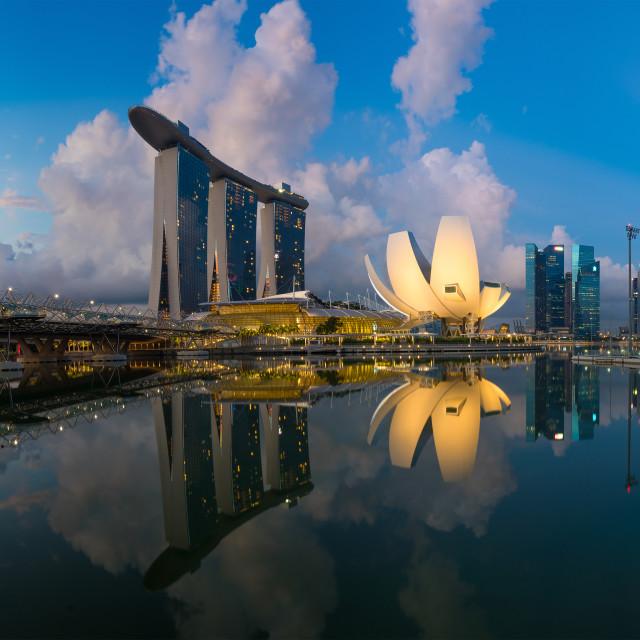 """Singapore,Singapore – May 7 2016 : Aerial view of Singapore city skyline in sunrise or sunset at Marina Bay, Singapore"" stock image"