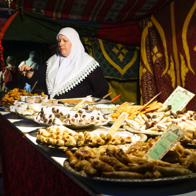 """moroccan woman selling sweets"" stock image"