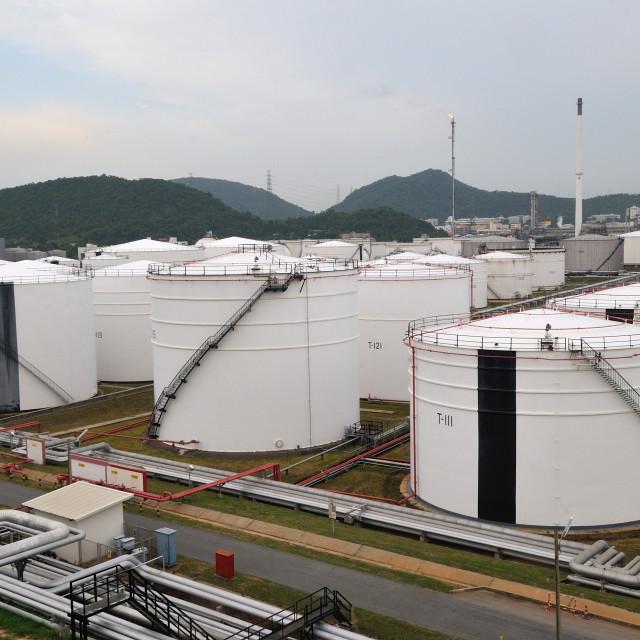 """CHONBURI - OCTOBER 5: White Oil Tanks and bicycles parking in Chonburi,..."" stock image"
