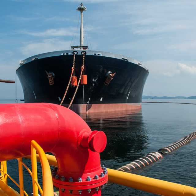 """Oil tanker is transferring oil to the cargo vessel"" stock image"