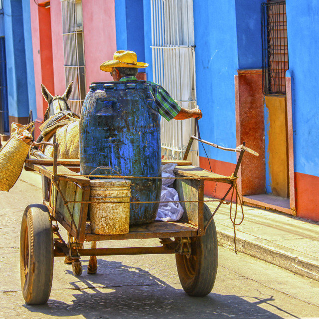 """Man on horse drawn cart on the street of Trinidad, Cuba"" stock image"