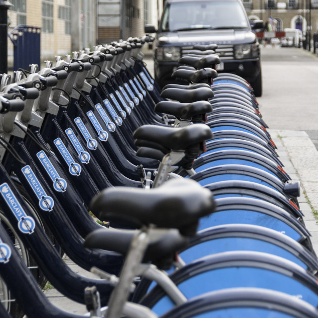 """Barclays Boris Bikes with Chelsea Tractor"" stock image"