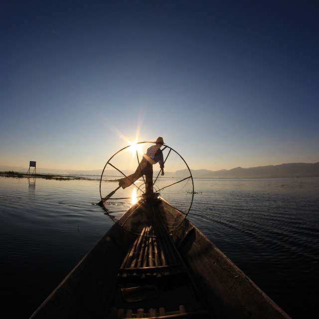 """silhouette of fisherman at inle lake"" stock image"