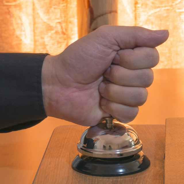 """Impatiently Ringing a Hotel Bell"" stock image"